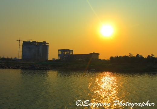 Sunset on the mekong river with sokha hotel under construction
